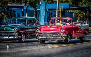 shutterstock_573257332-Red-american-Chevrolet-Cabriolet-classic-car-with-tourists-on-the-street-in-Santa-Clara-Cuba