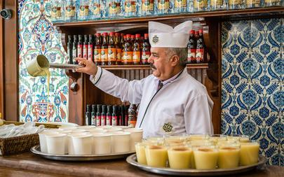 shutterstock_392569483-Man-is-selling-boza-which-is-a-popular-fermented-beverage-in-Istanbul_-Turkey