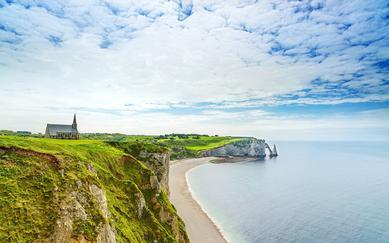 shutterstock_142883824-Etretat-Aval-cliff_-church_-natural-arch-landmark-and-blue-ocean.-Aerial-view.-Normandy_-France_-Europe