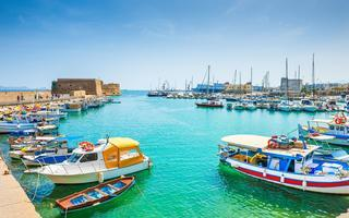 shutterstock_398399071-Old-venetian-harbor-with-boats-in-Heraklion_-Crete