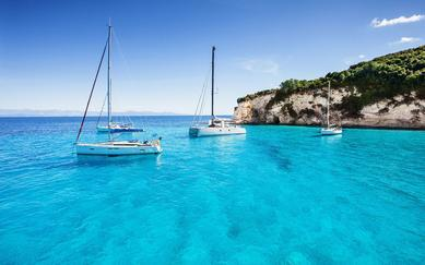 shutterstock_551334427Sailboats-in-a-beautiful-bay_-Paxos-island_-Greece