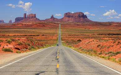shutterstock_110169224-Desert-highway-leading-into-Monument-Valley_-Utah_-USA