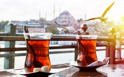 shutterstock_352487714-Turkish-tea-cup-on-the-background-of-port-in-Istanbul