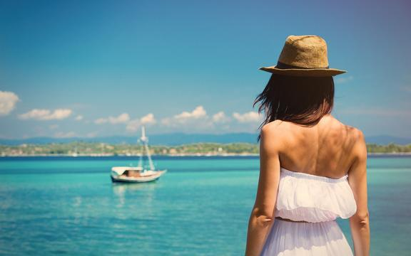 shutterstock_440383279-photo-of-the-beautiful-young-woman-in-Greece-on-the-sea-background