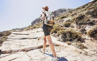 shutterstock_434090377Hiker-traveler-woman-on-a-hiking-trail_-travel-and-active-lifestyle-concept_-Greece-island