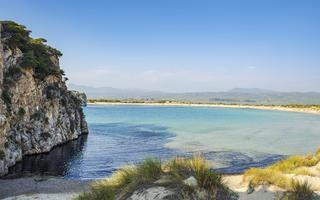 shutterstock_340479719-The-back-side-of-the-famous-voidokilia-beach-near-the-old-Navarino-castle-next-to-Gialova-in-Messinia