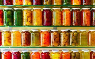 shutterstock_617987564-Various-jars-with-Home-Canning-Fruits-and-Vegetables-jam-on-glass-shelves