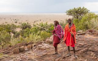 shutterstock_173475662-Two-Masai-warriors-standing-and-looking-away_-soft-focus